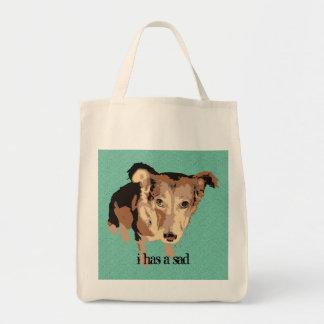 i has a sad cute dog tote bag