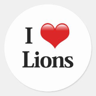 I leones del corazón pegatina redonda