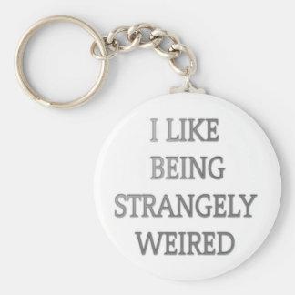 I like being strangely weird .png basic round button keychain