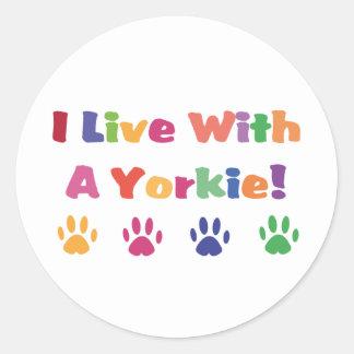 I Live With A Yorkie Round Sticker
