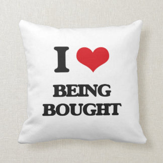 I Love Being Bought Throw Pillows