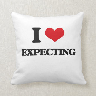 I love EXPECTING Throw Pillows
