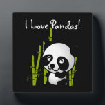 """I Love Pandas Panda bear with bamboo Plaque<br><div class=""""desc"""">Display your love for pandas to the world. I love pandas display plaque. A cute and adorable illustration of a black and white panda bear sitting down and looking happy,  friendly and lovable. Black background really makes this little panda pop!</div>"""