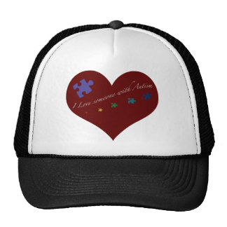 I love someone with Autism Heart Trucker Hats