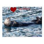 I postal de las nutrias de mar del corazón