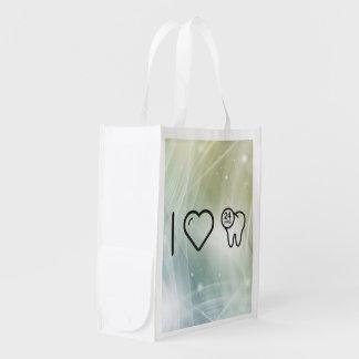 I protecciones del dentista del corazón bolsas reutilizables