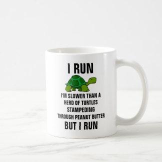 I run I'm slower than a herd of turtles stampedin Coffee Mug