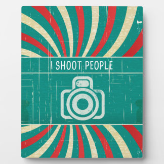 I shoot people - camera in retro background plaque