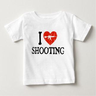 I tiroteo del corazón playera de bebé