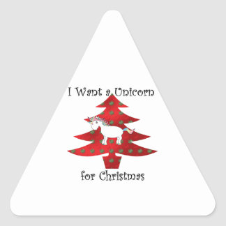 I want a unicorn for Christmas on red Triangle Sticker