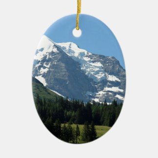 Ice and snow in the Swiss Alps Double-Sided Oval Ceramic Christmas Ornament