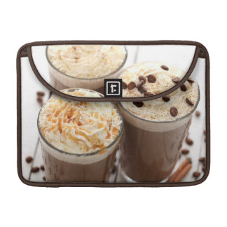 Ice coffee with whipped cream and coffee beans sleeve for MacBook pro