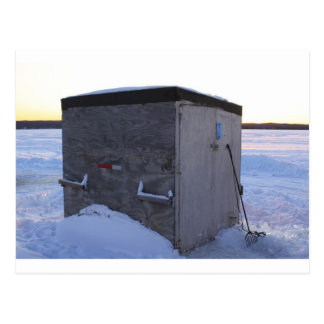 Ice fishing house at dusk. postcard