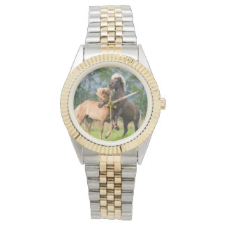 Icelandic horses playing and rearing wristwatch
