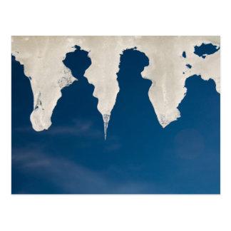 Icicles against a blue sky postcard