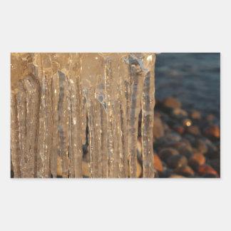 Icicles on a beach rectangular sticker