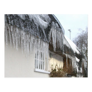 Icicles on a thatched cottage postcard