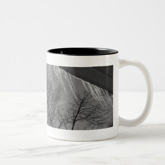 Icicles on roof and sun Two-Tone coffee mug