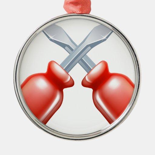 Icono cruzado de los destornilladores adorno redondo plateado