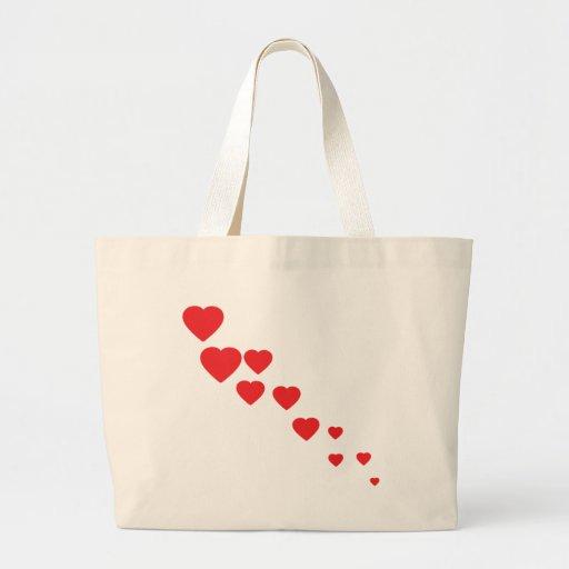 icono de los corazones del vuelo bolsa