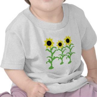 icono de tres flores del sol camisetas