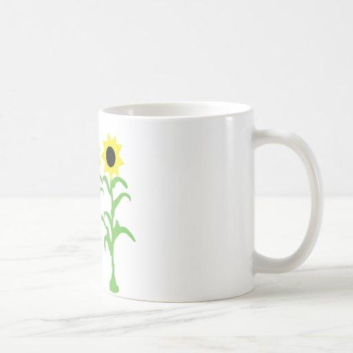 icono de tres flores del sol taza