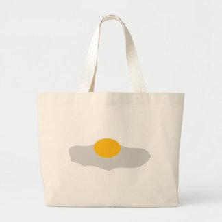 Icono del huevo frito bolsas