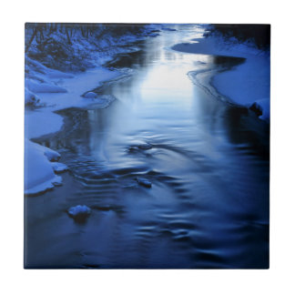 Icy and snowy river with winter blue small square tile