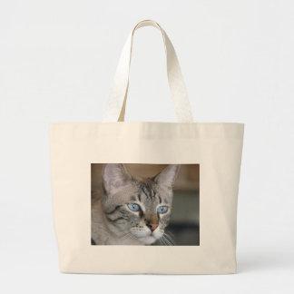 Icy blue eyes large tote bag