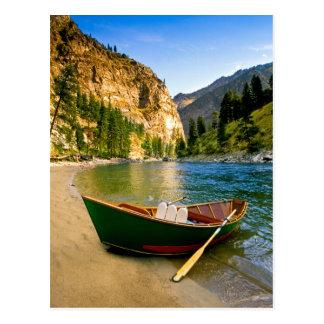 IDAHO, Fishing boat on a sandy beach in the Postcard