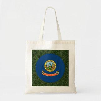 Idaho Flag on Grass Tote Bag