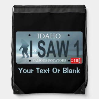 """Idaho """"I Saw 1"""" Sasquatch License Plate Drawstring Bags"""