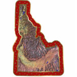"""Idaho Map Christmas Ornament Cut Out<br><div class=""""desc"""">This acrylic ornament shaped from a relief map of Idaho surrounded by festive trim will add novel Idahoan flair to your seasonal decorations. Also available as a pin,  magnet or keychain.  Map derived from images at nationalatlas.gov.</div>"""