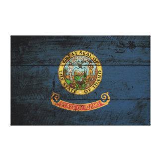Idaho State Flag on Old Wood Grain Canvas Print