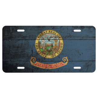 Idaho State Flag on Old Wood Grain License Plate