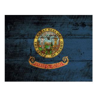 Idaho State Flag on Old Wood Grain Postcard