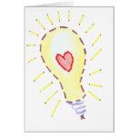 Idea brillante de la bombilla - corazón felicitación
