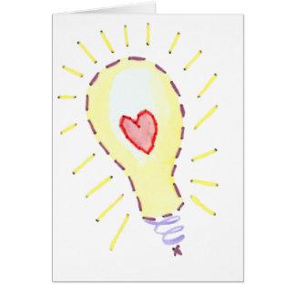 Idea brillante de la bombilla - corazón tarjeta de felicitación