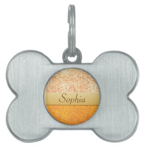 Identificación anaranjada reluciente femenina de l placa de mascota