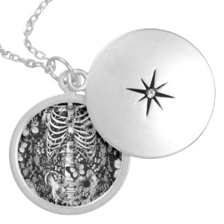 Idiopathic idiot, lace rib cage with poppies silver plated necklace
