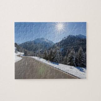 Idyllic empty road thrugh a winter landscape, 2 jigsaw puzzle