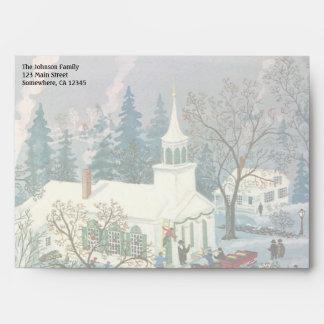 Iglesia del navidad del vintage en nieve con la sobre