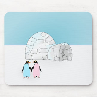 Igloo with colored penguins mouse pad