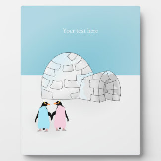 Igloo with colored penguins plaque