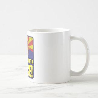 Ilegal no es una raza tazas de café