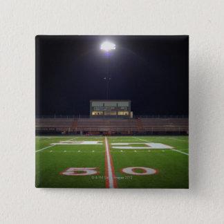Illuminated American football field at night Button