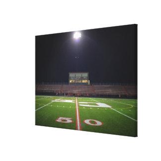Illuminated American football field at night Canvas Print