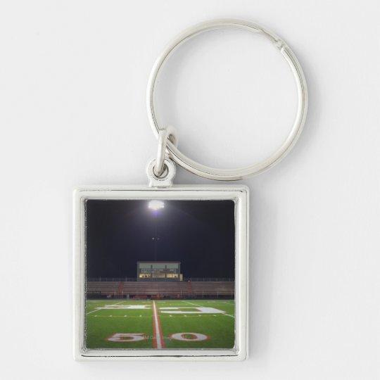 Illuminated American football field at night Keychain