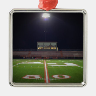 Illuminated American football field at night Square Metal Christmas Ornament