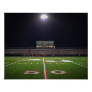 Illuminated American football field at night Print